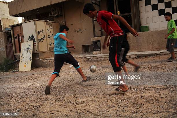 Boys play soccer in an alley on July 10 2011 in Baghdad Iraq As the deadline for the departure of the remaining American forces in Iraq approaches...