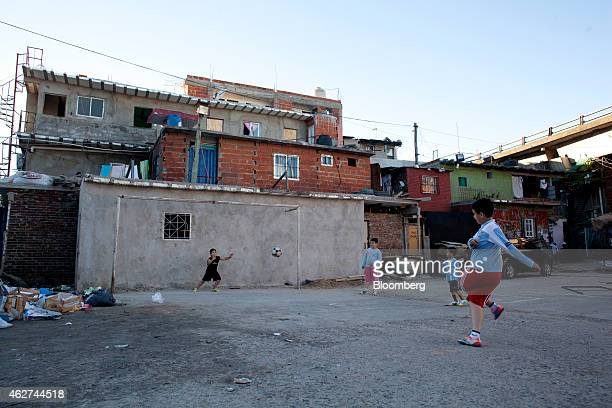 Boys play soccer in the Villa 31 neighborhood of Buenos Aires Argentina on Wednesday Nov 5 2014 About 26000 people live in the 02 squaremile area of...