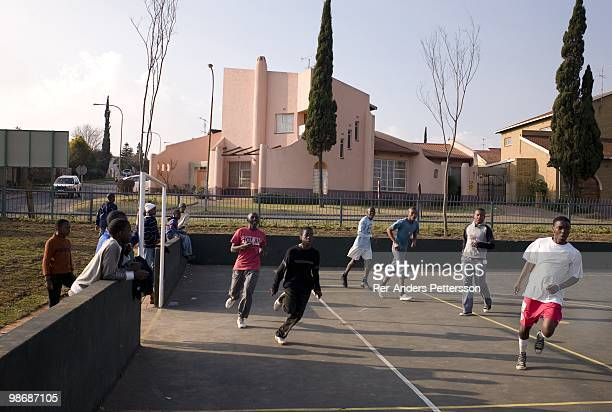 Boys play soccer on a court on July 13 2008 in Diepkloof a posh section of Soweto South Africa Soweto is the country's biggest township and the...