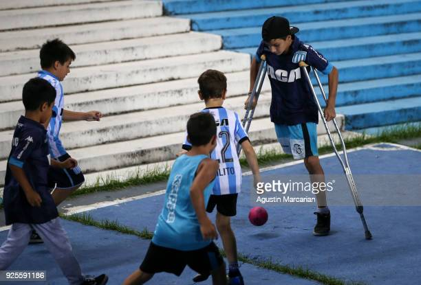 Boys play with a ball before the Group E match between Racing Club and Cruzeiro as part of Copa CONMEBOL Libertadores 2018 at Juan Domingo Peron...