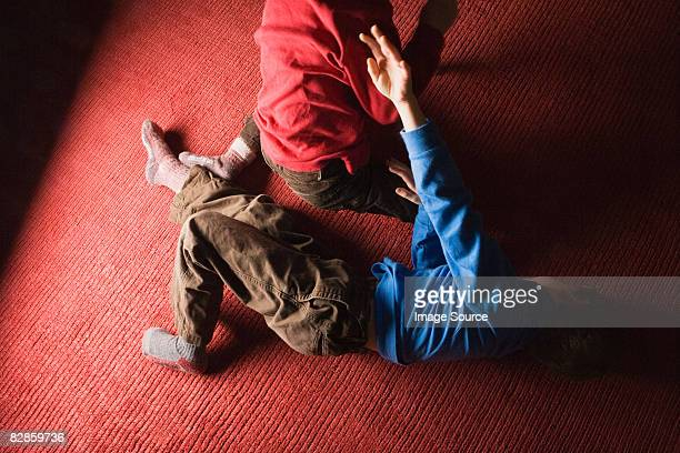 boys playfighting - rough housing stock pictures, royalty-free photos & images