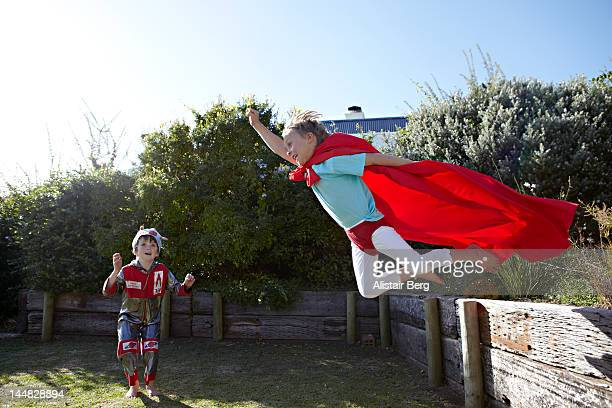 Boys playing at being superheroes