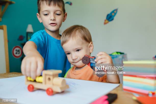 Boys Playing At Home