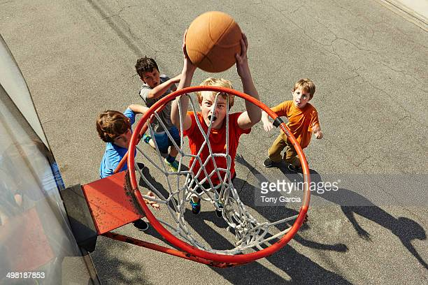 boys playing basketball, high angle - sporting term stock-fotos und bilder