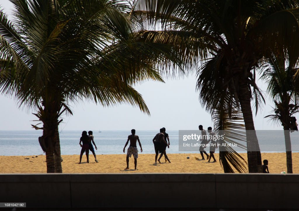 Boys playing beach soccer, Luanda Province, Luanda, Angola on July