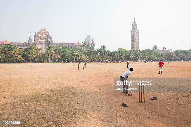 Boys playing cricket at the Oval in Mumbai,India