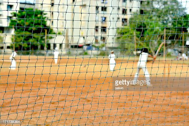 Boys playing cricket in suburbs of Mumbai. Cricket is more of a religion than just a game in India. Every kid dreams of becoming a world class...