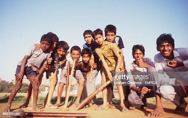 Boys playing cricket in the streets Bombay