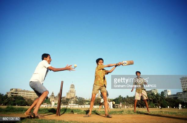 Boys playing cricket in the streets of Bombay