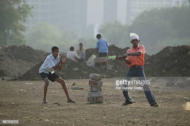 Boys playing cricket with improvised wicket, Bombay, India