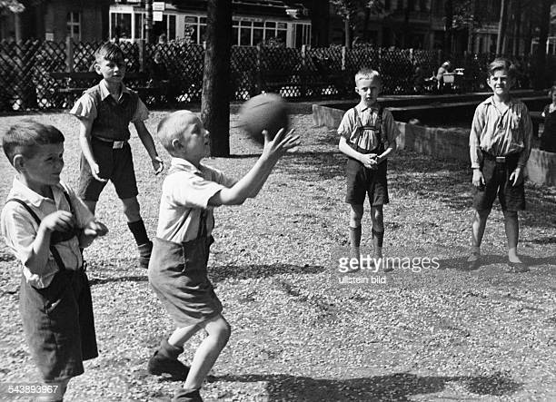 Boys playing dodgeball 1934 Photographer Wolf Strache Published by 'Koralle' 20/1934Vintage property of ullstein bild