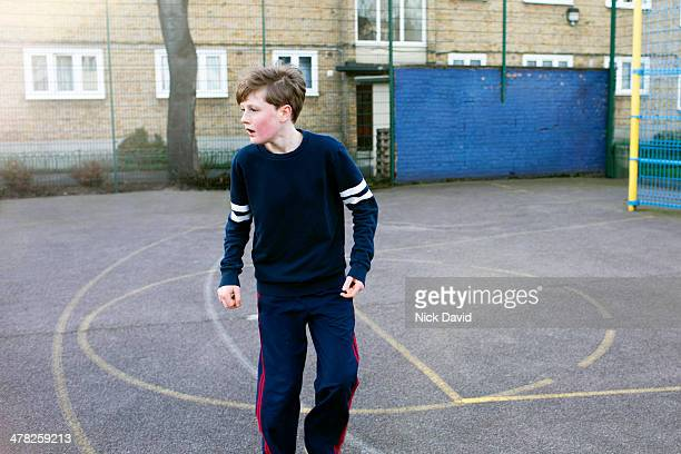 boys playing football - football bulge stock pictures, royalty-free photos & images