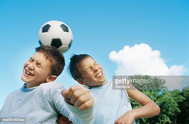 Boys (10-12) playing football