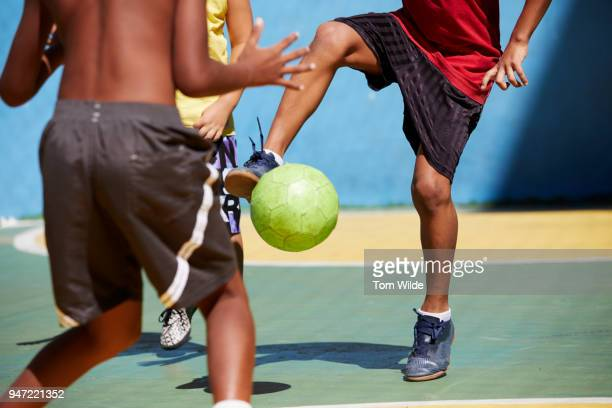 boys playing football/soccer - brazil stock pictures, royalty-free photos & images