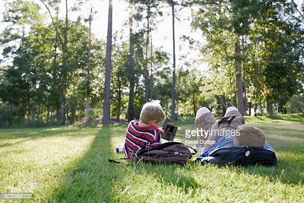 Boys playing handheld video games