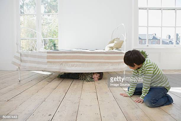 Boys playing hide and seek