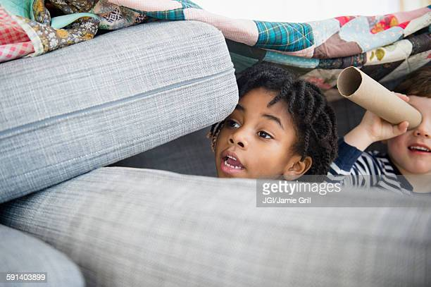 boys playing in pillow fort - fortress stock pictures, royalty-free photos & images