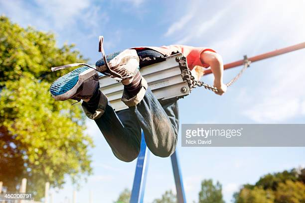 boys playing in the park - swinging stock pictures, royalty-free photos & images