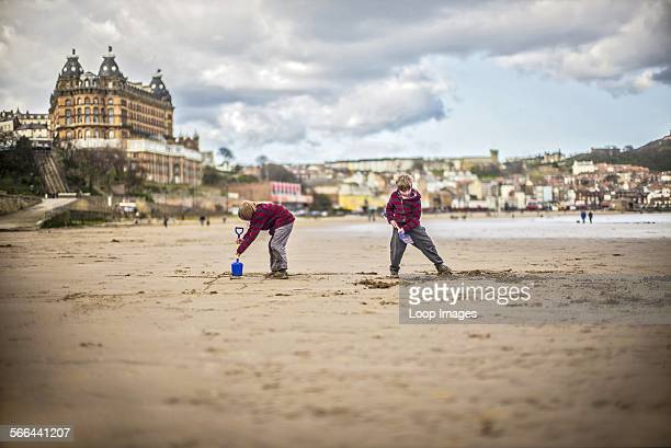 Boys playing on South Beach in Scarborough