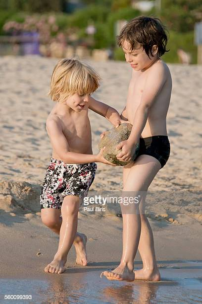 Boys playing on the beach, Plage d'Arone, Corsica