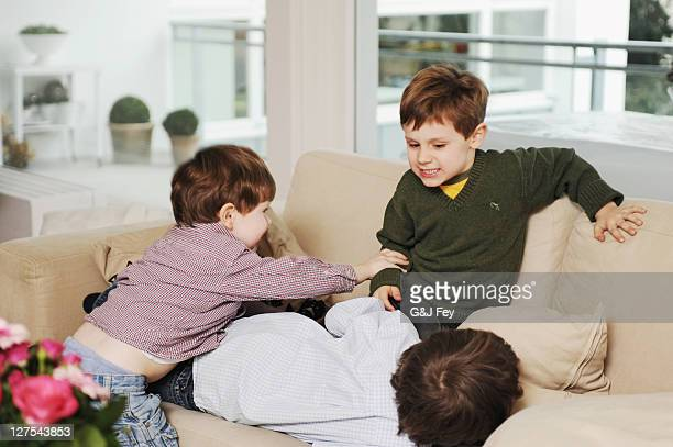 Boys playing on the sofa