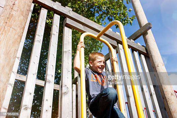 boys playing outside in the park - climbing stock pictures, royalty-free photos & images