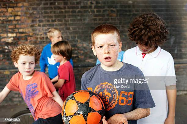 boys playing outside in the park - only boys stock pictures, royalty-free photos & images