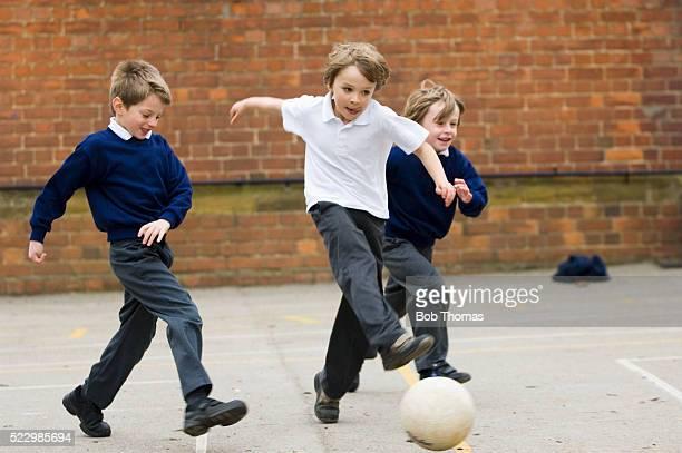 Boys Playing Soccer at Recess