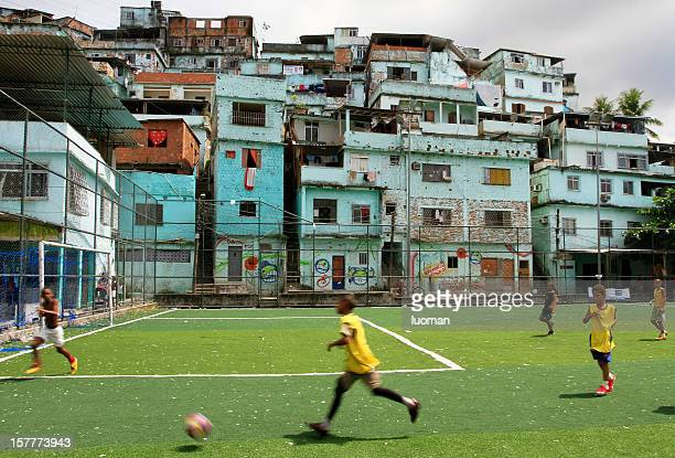 Boys playing soccer in a favela
