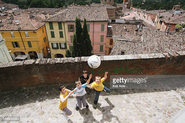 Boys Playing Soccer In Street