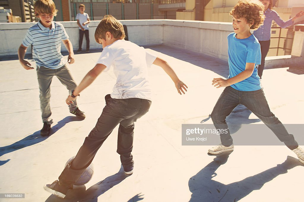Boys (8 - 10 years) playing soccer : Stock Photo