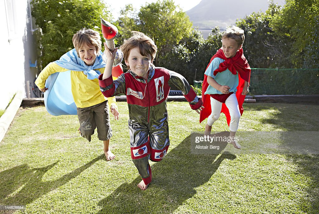 Boys playing together in a garden : Stock Photo