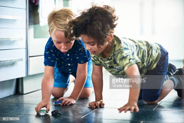boys playing toy cars - toy car stock pictures, royalty-free photos & images