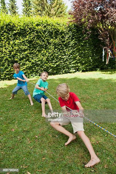 Boys playing tug-of-war on a birthday party