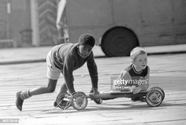 Boys playing with a gocart in the East End of London 1960s