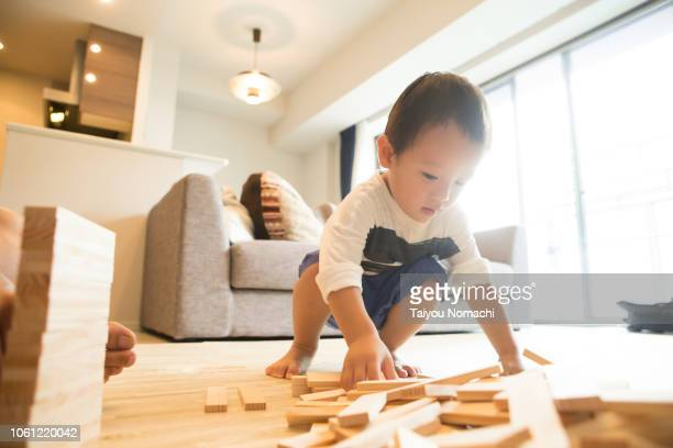 Boys playing with building blocks