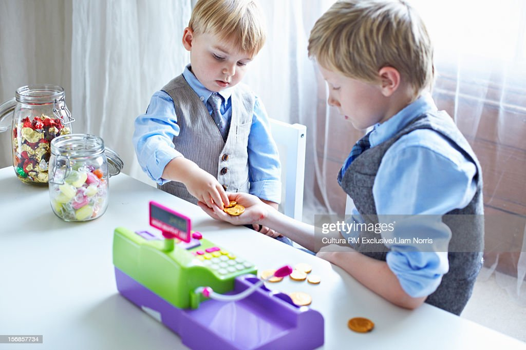 Boys playing with cash register : Foto de stock