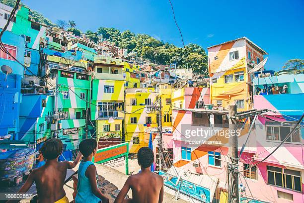 Boys playing with kites in favela.