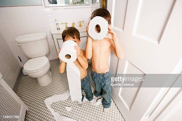 Boys playing with toilet paper
