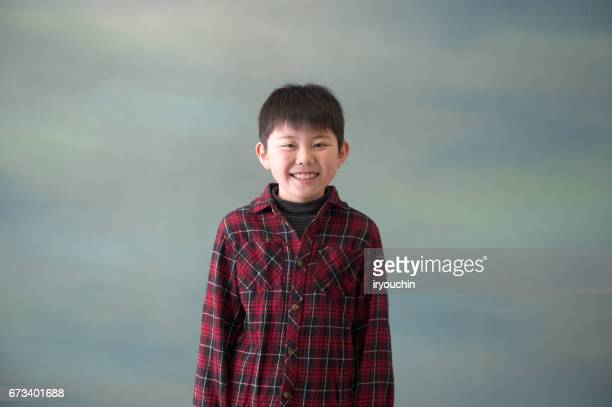 boy's portrait - checked shirt stock photos and pictures