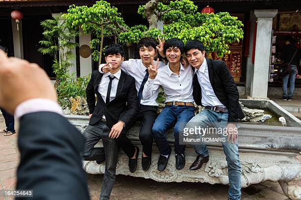 Boys posing for a picture in the Temple of Literature, Hanoi, Vietnam