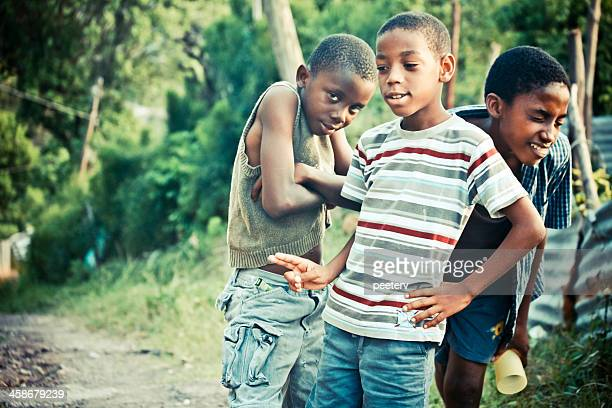 boys posing in the street. - kingston jamaica stock pictures, royalty-free photos & images