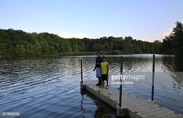 Boys posing on a pier, Findley Lake, Wellington, Ohio, USA
