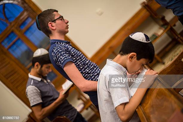 Boys pray during Mincha service in the Sixdomed Synagogue in Qrmz Qsb or Red Town Quba district of Azerbaijan on 28 September 2016 Qrmz Qsb is a...