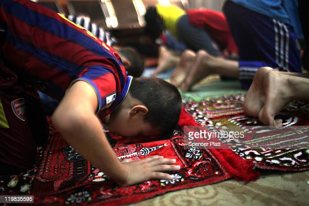 Boys pray in the Al-Baraum orphanage on July 25, 2011 in Baghdad, Iraq. The state owned orphanage has about 50 children currently with the number...