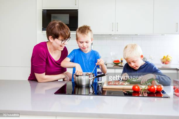 Boys preparing food in kitchen