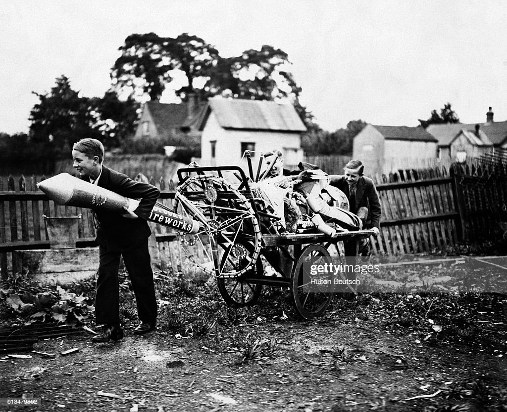 Boys push home a cart full of fireworks for a Guy Fawkes celebration.
