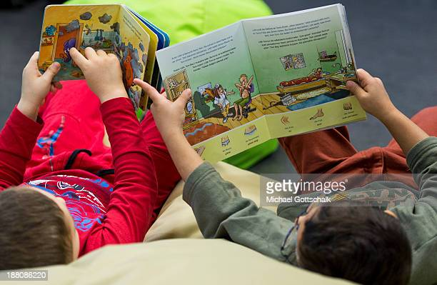 Boys read children's books during the presentation of Project 'Lesestart' in a Libary for Children on November 15 2013 in Berlin Germany The Project...