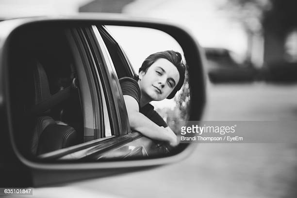 Boys Reflection In Side-View Mirror