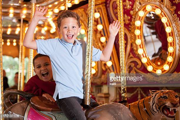 Boys riding carousel